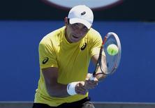 Marinko Matosevic of Australia hits a return to Kei Nishikori of Japan during their men's singles at the Australian Open 2014 tennis tournament in Melbourne January 14, 2014. REUTERS/Jason Reed