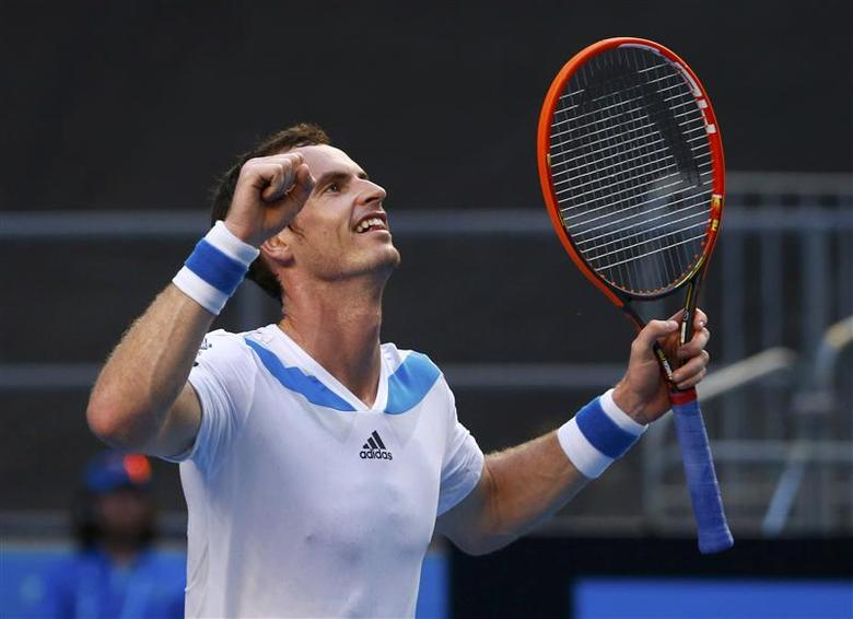 Andy Murray of Britain celebrates defeating Go Soeda of Japan during their men's singles match at the Australian Open 2014 tennis tournament in Melbourne January 14, 2014. REUTERS/David Gray