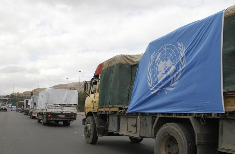 Trucks carrying food aid offered from UNRWA make their way to the besieged camp of al-Yarmouk south of Damascus, which is controlled by opposition fighters, January 13, 2014. REUTERS/Khaled al-Hariri
