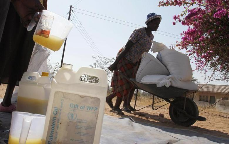 A Zimbabwean woman collects her monthly food allocation from Chitowa clinic in Buhera District about 405 km (251 miles) east of the capital Harare July 12, 2012. REUTERS/Philimon Bulawayo