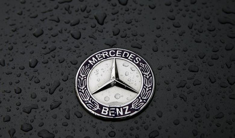 The logo of German car manufacturer Mercedes-Benz, a subsidiary of Daimler AG, is pictured covered with raindrops at a Mercedes-Benz branch in Frankfurt, October 23, 2013. REUTERS/Kai Pfaffenbach