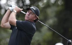 Phil Mickelson of the U.S. tees off on the 10th hole during the second round of the WGC-HSBC Champions golf tournament in Shanghai November 1, 2013. REUTERS/Aly Song