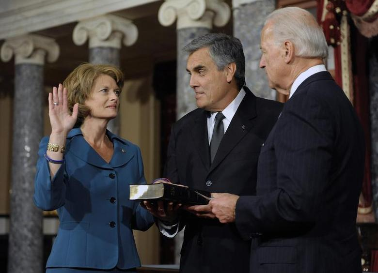 U.S. Senator Lisa Murkowski (R-AK) (L), with her husband Verne Martell (C), takes part in a ceremonial re-enactment of her swearing-in by Vice President Joe Biden (R) in the Old Senate Chamber at the U.S. Capitol in Washington, January 5, 2011. REUTERS/Jonathan Ernst