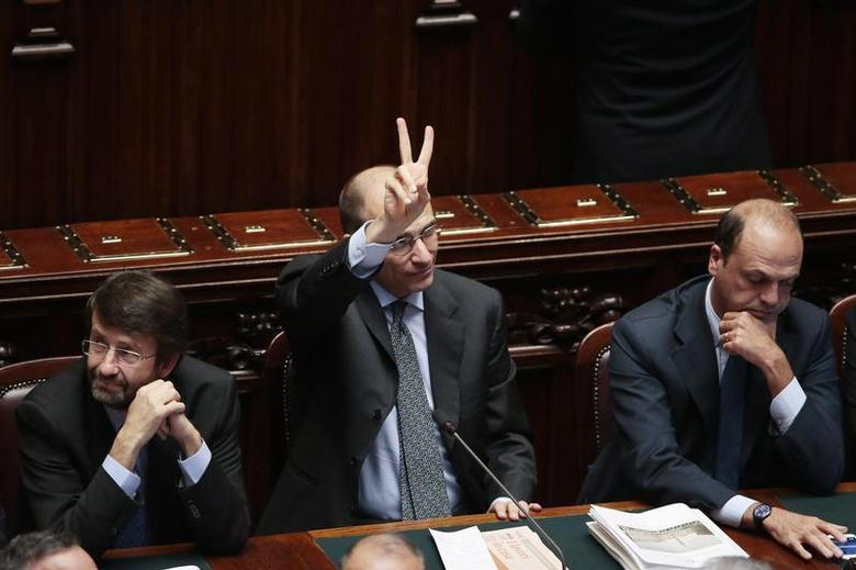 Italy's Prime Minister Enrico Letta (C), flanked by Interior Minister Angelino Alfano (R) and Democratic Party (PD) member Dario Franceschini, gestures after asking for a possible call for a confidence vote immediately at the Lower house of the parliament in Rome, October 2, 2013. REUTERS/Remo Casilli