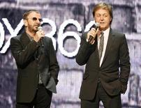 """Ringo Starr (L) and Paul McCartney, of The Beatles, introduce the new video game """"The Beatles: Rock Band"""" at the Microsoft XBox 360 E3 2009 media briefing in Los Angeles June 1, 2009. REUTERS/Fred Prouser"""