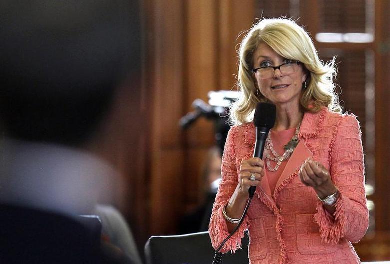 Texas State Democratic Senator Wendy Davis questions the state's Republican Senator Glenn Hegar, sponsor of Senate Bill 1 (SB1), as the state Senate meets to consider legislation restricting abortion rights in Austin, Texas July 12, 2013. REUTERS/Mike Stone