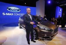 Ford of Europe CEO Steve Odell, poses next to Ford S-Max concept car during a media preview day at the Frankfurt Motor Show (IAA) September 10, 2013. REUTERS/Wolfgang Rattay