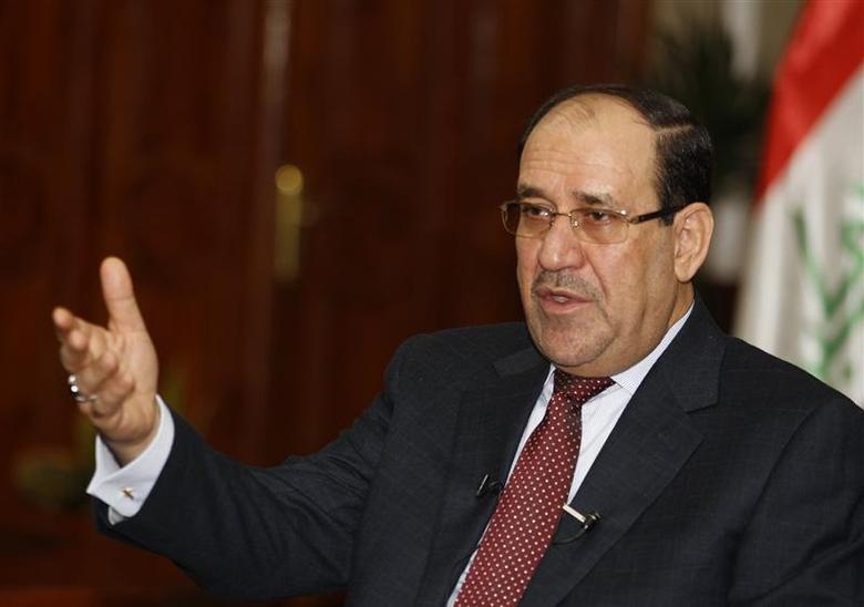 Iraq's Prime Minister Nuri al-Maliki speaks during an interview with Reuters in Baghdad January 12, 2014. IRAQ/MALIKI