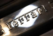 A Ferrari logo is pictured on the footboard of the newly launched F12 Berlinetta car during the second media day of the 82nd Geneva Auto Show at the Palexpo Arena in Geneva March 7, 2012. REUTERS/Denis Balibouse