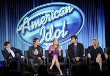 "Host Ryan Seacrest (L-R), Judges Keith Urban, Jennifer Lopez, Harry Connick, Jr., and executive producer Trish Kinane of ""American Idol"" take part in Fox Broadcasting Company's part of the Television Critics Association (TCA) Winter 2014 presentations in Pasadena, California, January 13, 2014. REUTERS/Kevork Djansezian"