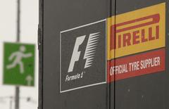 An emergency exit sign is pictured next to a truck of Italian official Formula One tyre supplier Pirelli in the paddock area of the Nuerburgring racing circuit July 3, 2013. REUTERS/Wolfgang Rattay