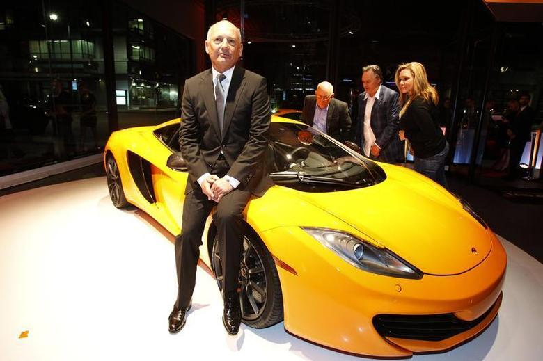 Ron Dennis, executive chairman of McLaren Automotive, sits on a MP4-12C during the opening of the first North American McLaren Automotive dealership in Beverly Hills, California January 10, 2012. REUTERS/Mario Anzuoni