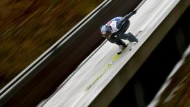 Austria's Thomas Morgenstern speeds down the ski jump during the first training jump for the fourth jumping of the four-hills tournament in Bischofshofen January 5, 2014. REUTERS/Dominic Ebenbichler