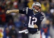 New England Patriots quarterback Tom Brady (12) reacts after a touchdown against the Indianapolis Colts in the first half during the 2013 AFC divisional playoff football game at Gillette Stadium. Mark L. Baer-USA TODAY Sports
