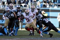 San Francisco 49ers running back Frank Gore (21) runs against Carolina Panthers strong safety Robert Lester (38) during the second half of the 2013 NFC divisional playoff football game at Bank of America Stadium. Jeremy Brevard-USA TODAY Sports