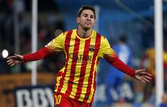 Barcelona's Lionel Messi celebrates after scoring his second goal against Getafe during their Spanish King's Cup soccer match at Colisseum Alfonso Perez stadium in Getafe January 16, 2014. REUTERS/Sergio Perez