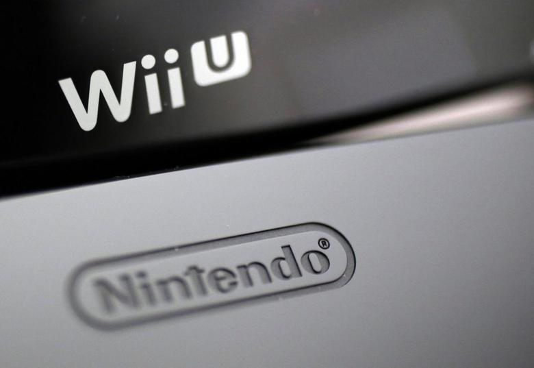 Logos are seen on Nintendo Co's Wii U game console (bottom) and its controller at the company's headquarters in Kyoto, western Japan in this January 7, 2013 file photo. REUTERS/Yuriko Nakao/Files