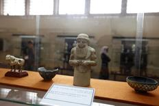 A limestone statuette from the archaelogical site of Warka is displayed at the National Museum of Iraq in Baghdad December 31, 2013. REUTERS/Ahmed Saad