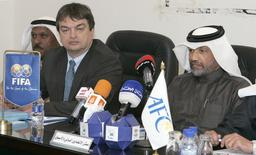 Asian Football Confederation's president, Mohammed Bin Hammam (R), and Jerome Champagne (2nd R) of FIFA, attend a meeting with Kuwaiti Clubs in Kuwait February 9, 2008. REUTERS/Tariq AlAli