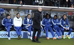 Chelsea manager Jose Mourinho (C) attends their English Premier League soccer match against Hull City at The KC Stadium in Hull, northern England, January 11, 2014. REUTERS/Nigel Roddis