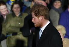 Britain's Prince Harry walks to a Christmas Day morning service at the church on the Sandringham Estate in Norfolk, eastern England, December 25, 2013. REUTERS/Andrew Winning