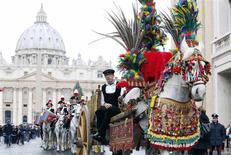 A traditional Sicilian chariot with a horse is seen in Saint Peter's Square at the Vatican January 17, 2014. REUTERS/Stefano Rellandini