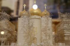 A model of a Russian Orthodox church and spiritual centre, to be built along the Seine River near the Eiffel Tower, is seen during a media presentation at the Russian ambassador's residence in Paris, January 17, 2014. REUTERS/Christian Hartmann