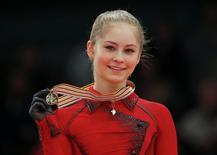 Gold medallist Julia Lipnitskaia of Russia poses during medal ceremony after the Ladies Free Skating event at the ISU European Figure Skating Championships in Budapest, January 17, 2014. REUTERS/Laszlo Balogh