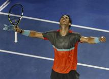Rafael Nadal of Spain reacts after winning his men's singles match against Gael Monfils of France at the Australian Open 2014 tennis tournament in Melbourne January 18, 2014. REUTERS/Jason Reed