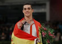 Gold medallist Javier Fernandez of Spain poses with medal after the Men Free Skating at the ISU European Figure Skating Championships in Budapest, January 18, 2014. REUTERS/Laszlo Balogh