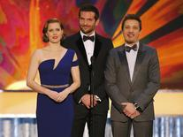"""Actors Amy Adams, Bradley Cooper (C) and Jeremy Renner introduce a clip from the film """"American Hustle"""" at the 20th annual Screen Actors Guild Awards in Los Angeles, California January 18, 2014. REUTERS/Mike Blake"""