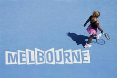 Serena Williams of the U.S. walks on the court during her women's singles match against Ana Ivanovic of Serbia at the Australian Open 2014 tennis tournament in Melbourne January 19, 2014. REUTERS/Jason Reed