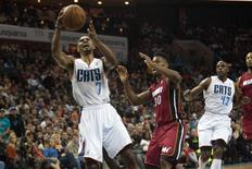 Jan 18, 2014; Charlotte, NC, USA; Charlotte Bobcats point guard Ramon Sessions (7) goes up for a shot during the second half against the Miami Heat at Time Warner Cable Arena. The Heat defeated the Bobcats 104-96 in overtime. Mandatory Credit: Jeremy Brevard-USA TODAY Sports