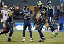 Jan 19, 2014; Seattle, WA, USA; Seattle Seahawks strong safety Kam Chancellor (31) celebrates with his teammates after making an interception against the San Francisco 49ers during the second half of the 2013 NFC Championship football game at CenturyLink Field. Kyle Terada-USA TODAY Sports