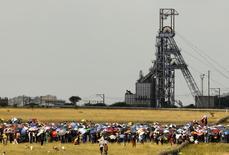 Striking miners gather for a meeting outside the Impala Platinum mine in Rustenburg, 120 km (74.6 miles) northwest of Johannesburg February 21, 2012. REUTERS/Sipiwe Sibeko