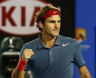 Roger Federer of Switzerland celebrates defeating Jo-Wilfried Tsonga of France during their men's singles match at the Australian Open 2014 tennis tournament in Melbourne January 20, 2014. REUTERS/Petar Kujundzic