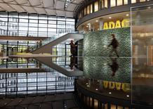 People walk inside the ADAC headquarter in Munich January 20, 2014. REUTERS/Michaela Rehle