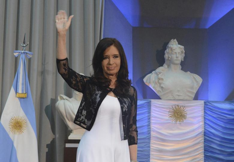 Argentina's President Cristina Fernandez de Kirchner waves as she attends an event to celebrate the 30th anniversary of Argentina's return to democracy at the Casa Rosada Presidential Palace in Buenos Aires December 10, 2013. REUTERS/Argentine Presidency/Handout