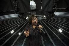Rose Fostanes,47, a Filipina caregiver, performs during a rehearsal for Israel's X-Factor talent show in Tel Aviv January 12, 2014. REUTER/Baz Ratner
