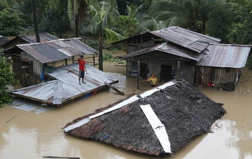 Super typhoon victims flee again as rains flood southern Philippines