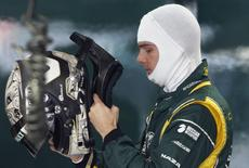Caterham Formula One test driver Giedo van der Garde of Netherlands puts on his helmet during the first practice session of the Indian F1 Grand Prix at the Buddh International Circuit in Greater Noida, on the outskirts of New Delhi, October 26, 2012. REUTERS/Vivek Prakash
