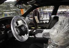 A Chrysler Group LLC employee works on the assembly line during the production launch of Chrysler vehicles at the assembly plant in Brampton January 7, 2011 file photo. REUTERS/Mike Cassese