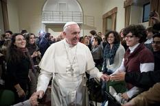 Pope Francis (C) is greeted during a pastoral visit at the Sacro Cuore Basilica in downtown Rome January 19, 2014. REUTERS/Osservatore Romano