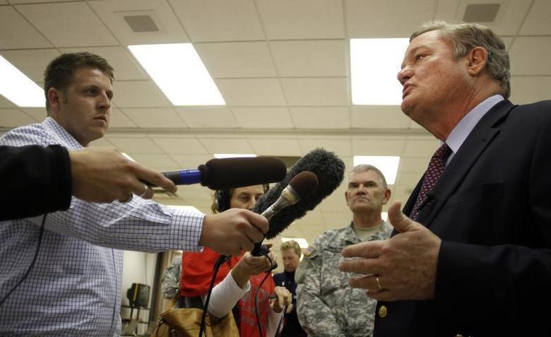 North Dakota Governor Jack Dalrymple (R) speaks with the media at the FEMA Disaster Recovery Center in Minot, North Dakota, June 27, 2011. REUTERS/Allen Fredrickson
