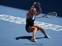 Dominika Cibulkova of Slovakia celebrates defeating Simona Halep of Romania in their women's singles quarter-final tennis match at the Australian Open 2014 tennis tournament in Melbourne January 22, 2014. REUTERS/David Gray