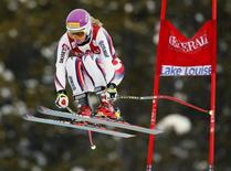Chemmy Alcott of Britain takes air past a gate during alpine skiing training for the Women's World Cup Downhill in Lake Louise, Alberta, November 29, 2012. REUTERS/Mike Blake