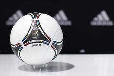 """A """"Tango 12"""" soccer ball for the upcoming Euro 2012 soccer tournament is displayed during a news conference at the sporting goods maker Adidas shop in Paris May 22, 2012. REUTERS/Gonzalo Fuentes"""
