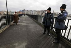 Russian Cossacks patrol the Adler district of Sochi January 22, 2014. REUTERS/Alexander Demianchuk