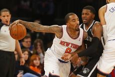 Jan 20, 2014; New York, NY, USA; New York Knicks shooting guard J.R. Smith (8) works against Brooklyn Nets shooting guard Joe Johnson (7) during the first half at Madison Square Garden. Jim O'Connor-USA TODAY Sports