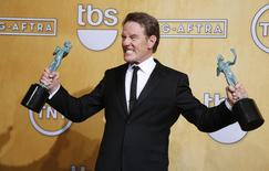 """Bryan Cranston winner of the Outstanding Performance by a Male Actor in a Drama Series award for his role in """"Breaking Bad"""" poses for photo backstage at the 20th annual Screen Actors Guild Awards in Los Angeles, California January 18, 2014. REUTERS/Lucy Nicholson"""